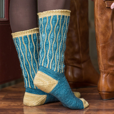 http://www.ravelry.com/patterns/library/karner-butterfly-socks